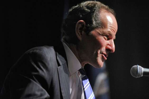 Former New York State Governor Eliot Spitzer  is interviewed by WAMC Northeast Public Radio President and CEO Dr. Alan Chartock in the Linda Norris Auditorium during Spitzer's first visit to Albany since his abrupt resignation  as governor in 2008,  on Sunday Oct. 21, 2012 in Albany, NY.  (Philip Kamrass /  Times Union) Photo: Philip Kamrass / 00019664A