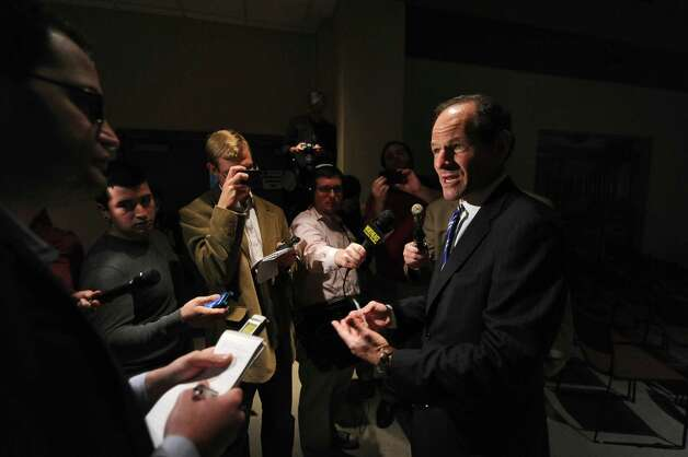 Former New York State Governor Eliot Spitzer answers questions from reporters after being interviewed by WAMC Northeast Public Radio President and CEO Dr. Alan Chartock in the Linda Norris Auditorium during Spitzer's first visit to Albany since his abrupt resignation  as governor in 2008,  on Sunday Oct. 21, 2012 in Albany, NY.  (Philip Kamrass /  Times Union) Photo: Philip Kamrass / 00019664A