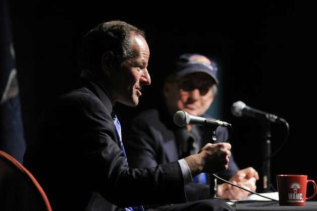 Former New York State Governor Eliot Spitzer, left, is interviewed by WAMC Northeast Public Radio President and CEO Dr. Alan Chartock, right, in the Linda Norris Auditorium during Spitzer's first visit to Albany since his abrupt resignation  as governor in 2008,  on Sunday Oct. 21, 2012 in Albany, NY.  (Philip Kamrass /  Times Union) Photo: Philip Kamrass / 00019664A