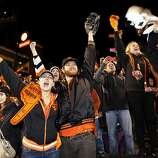 Kyle Haraszthy (center), of San Francisco celebrates after the San Francisco Giants defeated the St. Louis Cardinals in game six of the National League Championship Series on Sunday, October 21, 2012 in San Francisco, Calif.