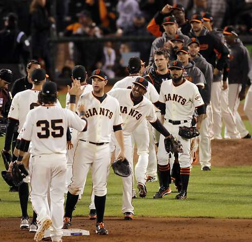 The Giants high celebrate in the infield after defeating the Cardinals in Game 6. The San Francisco Giants played the St. Louis Cardinals in Game 6 of the National League Championship Series at AT&T Park on Sunday, October 21, 2012, in San Francisco, Calif., The Giants defeated the Cardinals 6-1 to stay alive in the series and force a game 7. Photo: Carlos Avila Gonzalez, The Chronicle
