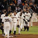 The Giants high celebrate in the infield after defeating the Cardinals in Game 6. The San Francisco Giants played the St. Louis Cardinals in Game 6 of the National League Championship Series at AT&T Park on Sunday, October 21, 2012, in San Francisco, Calif., The Giants defeated the Cardinals 6-1 to stay alive in the series and force a game 7.