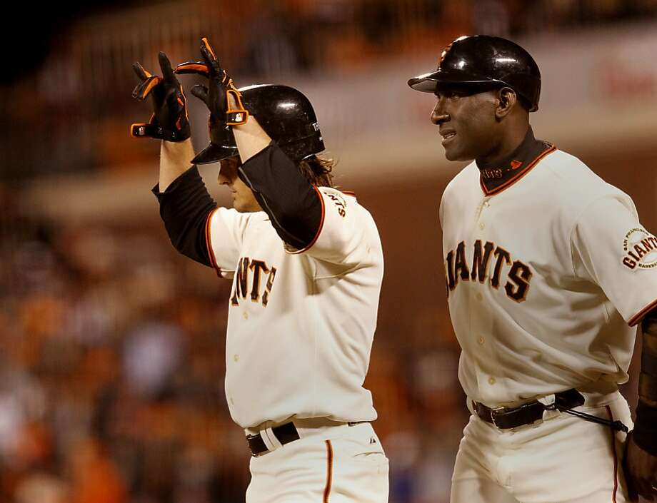 Ryan Theriot waved after his base hit in the 8th scored the Giants final run. First base coach Roberto Kelly is at right.  The San Francisco Giants defeated the St. Louis Cardinals 6-1 to tie up the NLCS series at AT&T park in San Francisco, Calif. Sunday October 21, 2012. Photo: Brant Ward, The Chronicle