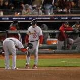 Allen Craig slams his helmet to the ground after grounding out to end the eighth inning. The San Francisco Giants played the St. Louis Cardinals in Game 6 of the National League Championship Series at AT&T Park on Sunday, October 21, 2012, in San Francisco, Calif., The Giants defeated the Cardinals 6-1 to stay alive in the series and force a game 7.