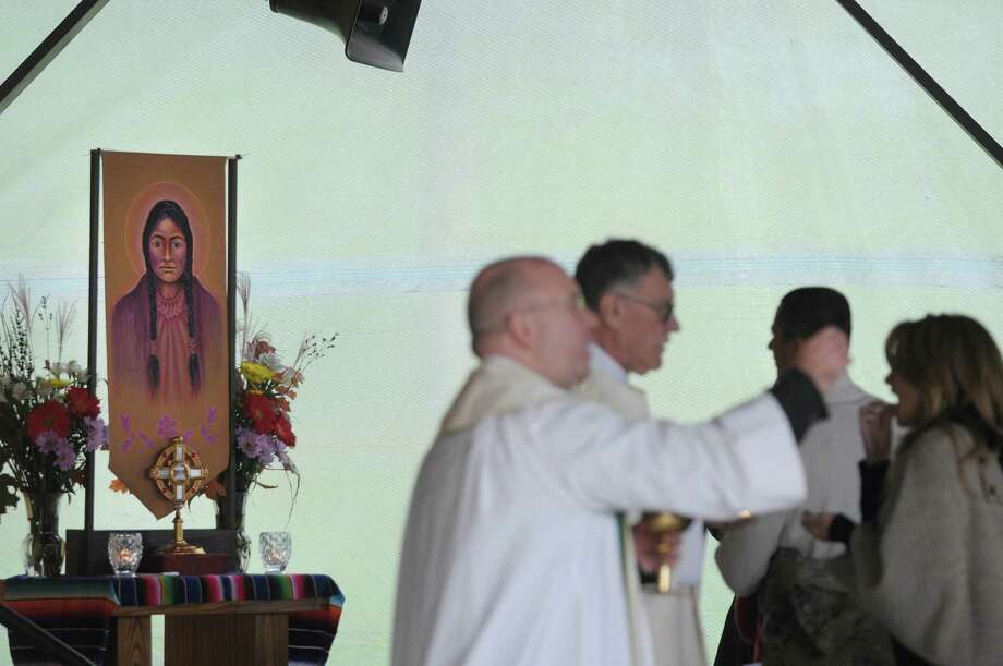 A small shrine to Kateri Tekakwitha is seen as communion is given out during a mass and canonization celebration for Kateri Tekakwitha at the National Kateri Shrine on Sunday, Oct. 21, 2012 in Fonda, NY.    (Paul Buckowski / Times Union) Photo: Paul Buckowski
