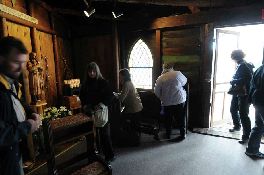 Visitors make their way into the chapel to pray near a statue of Kateri Tekakwitha following a mass and canonization celebration for Kateri Tekakwitha at the National Kateri Shrine on Sunday, Oct. 21, 2012 in Fonda, NY.    (Paul Buckowski / Times Union) Photo: Paul Buckowski