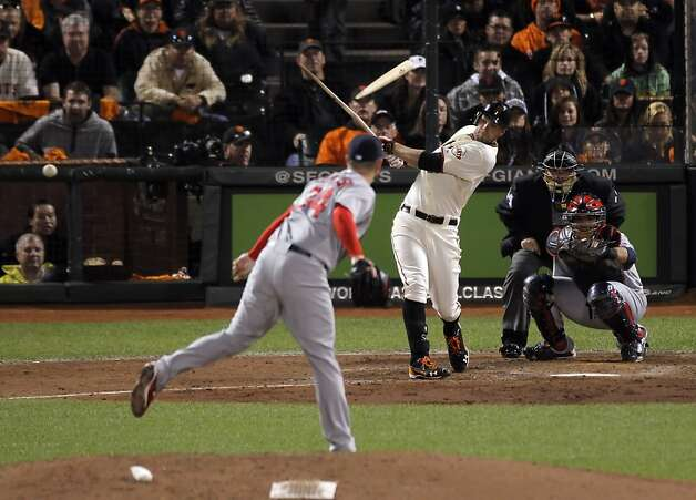 Brandon Belt breaks his bat as he hits a ball sharply past Daniel Descalso and would later score on a hit by Ryan Theriot on the eighth inning. The San Francisco Giants played the St. Louis Cardinals in Game 6 of the National League Championship Series at AT&T Park on Sunday, October 21, 2012, in San Francisco, Calif., The Giants defeated the Cardinals 6-1 to stay alive in the series and force a game 7. Photo: Carlos Avila Gonzalez, The Chronicle