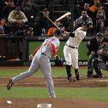 Brandon Belt breaks his bat as he hits a ball sharply past Daniel Descalso and would later score on a hit by Ryan Theriot on the eighth inning. The San Francisco Giants played the St. Louis Cardinals in Game 6 of the National League Championship Series at AT&T Park on Sunday, October 21, 2012, in San Francisco, Calif., The Giants defeated the Cardinals 6-1 to stay alive in the series and force a game 7.