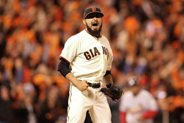 SAN FRANCISCO, CA - OCTOBER 21:  Sergio Romo #54 of the San Francisco Giants reacts after recording the last out as the Giants defeat the St. Louis Cardinals 6-1 in Game Six of the National League Championship Series at AT&T Park on October 21, 2012 in San Francisco, California.  (Photo by Christian Petersen/Getty Images) ***BESTPIX*** Photo: Christian Petersen, Getty Images / 2012 Getty Images