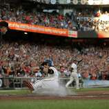 Marco Scutaro scores on a fielder's choice on a ball hit by Buster Posey in the first inning. The San Francisco Giants played the St. Louis Cardinals in Game 6 of the National League Championship Series at AT&T Park on Sunday, October 21, 2012, in San Francisco, Calif., The Giants defeated the Cardinals 6-1 to stay alive in the series and force a game 7.
