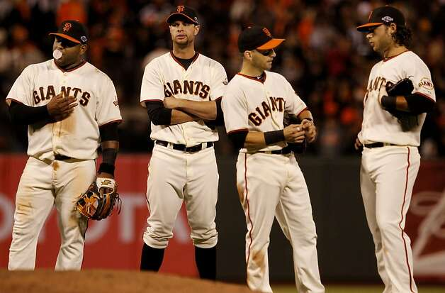 The Giants infield, l-r, Pablo Sandoval, Brandon Belt Marco Scutaro and Brandon Crawford waited for a pitching change in the 8th inning. The San Francisco Giants defeated the St. Louis Cardinals 6-1 to tie up the NLCS series at AT&T park in San Francisco, Calif. Sunday October 21, 2012. Photo: Brant Ward, The Chronicle