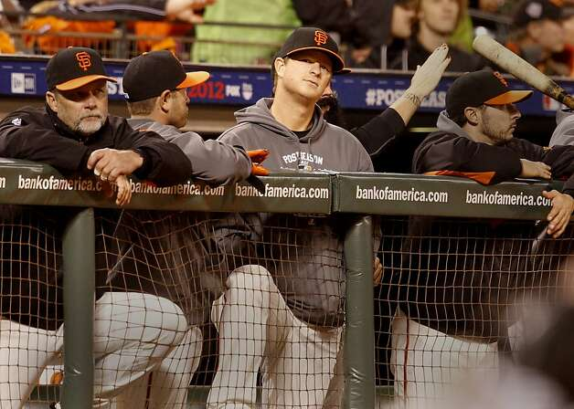 Mondays starter Matt Cain (center) watched the end of the game from the dugout. The San Francisco Giants defeated the St. Louis Cardinals 6-1 to tie up the NLCS series at AT&T park in San Francisco, Calif. Sunday October 21, 2012. Photo: Brant Ward, The Chronicle