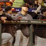 Mondays starter Matt Cain (center) watched the end of the game from the dugout. The San Francisco Giants defeated the St. Louis Cardinals 6-1 to tie up the NLCS series at AT&T park in San Francisco, Calif. Sunday October 21, 2012.