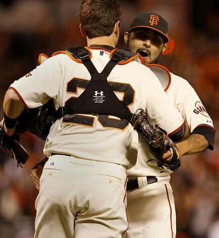 Sergio Romo (right) got a hug from Buster Posey at the end of the game. The San Francisco Giants defeated the St. Louis Cardinals 6-1 to tie up the NLCS series at AT&T park in San Francisco, Calif. Sunday October 21, 2012. Photo: Brant Ward, The Chronicle