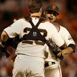 Sergio Romo (right) got a hug from Buster Posey at the end of the game. The San Francisco Giants defeated the St. Louis Cardinals 6-1 to tie up the NLCS series at AT&T park in San Francisco, Calif. Sunday October 21, 2012.