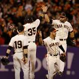 Angel Pagan went high in the air to congratulate 35 Brandon Crawford as Gregor Blanco (center) and 19 Marco Scutaro joined the celebration at the end of the game. The San Francisco Giants defeated the St. Louis Cardinals 6-1 to tie up the NLCS series at AT&T park in San Francisco, Calif. Sunday October 21, 2012.