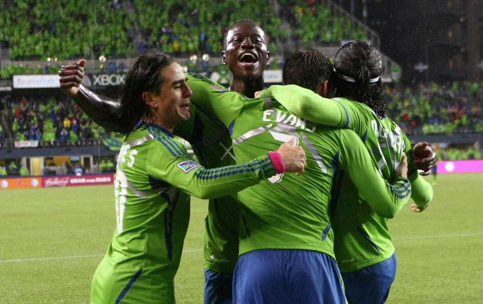 Seattle Sounders players, from left, Mauro Rosales, Eddie Johnson, Brad Evans and Fredy Montero cele