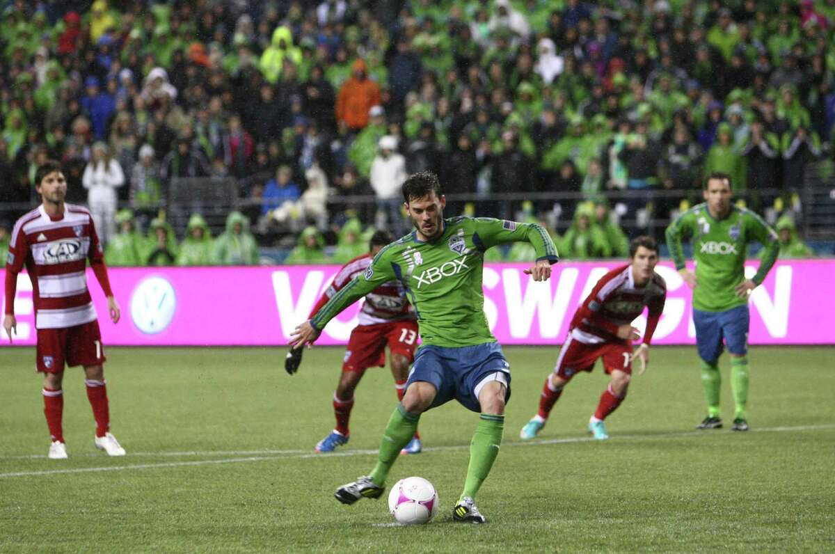 Sounders player Brad Evans fires in a penalty kick against FC Dallas for a goal in the first half.