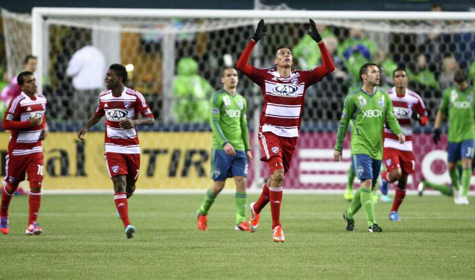 FC Dallas player Blas Perez reacts after scoring a goal against the Sounders in the first half.