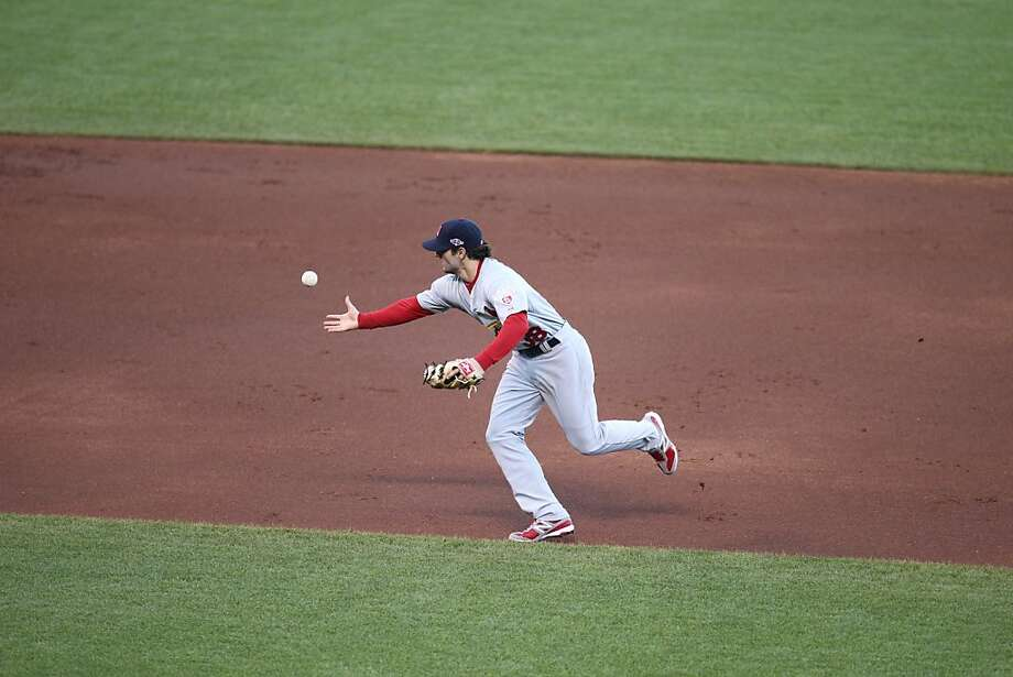 Cardinals' shortstop Pete Kozma commits an error in the 2nd inning allowing Brandon Belt to score during game 6 of the NLCS at AT&T Park on Sunday, Oct. 21, 2012 in San Francisco, Calif. Photo: Lance Iversen, The Chronicle