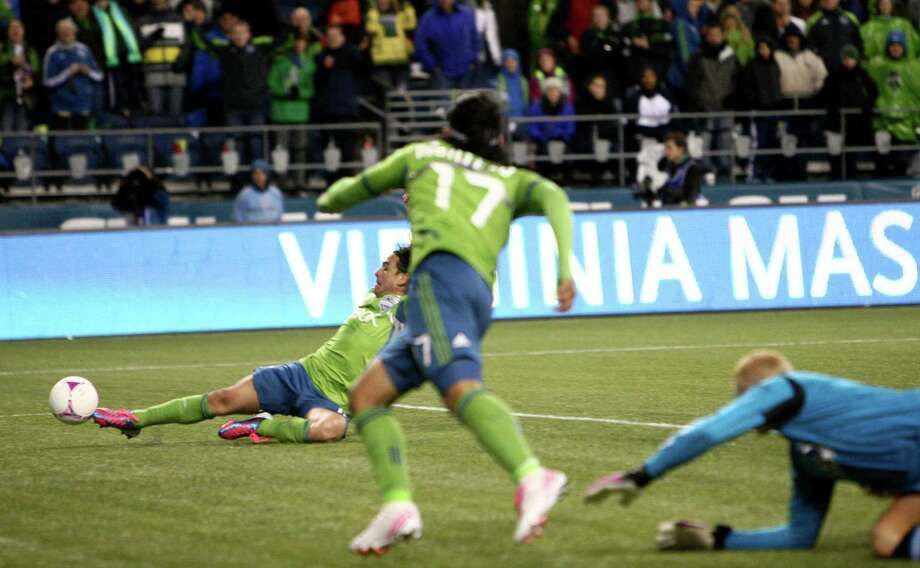 Sounders player Mauro Rosales puts in a goal with an assist from Fredy Montero (17) in the second half. Photo: JOSHUA TRUJILLO / SEATTLEPI.COM
