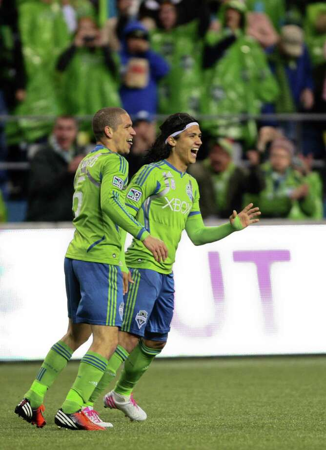Sounders player Fredy Montero and teammate Osvaldo Alonso react after teammate Mauro Rosales put in a goal with an assist from Montero in the second half. Photo: JOSHUA TRUJILLO / SEATTLEPI.COM