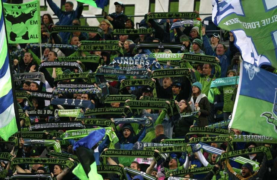 Sounders fans cheer. Photo: JOSHUA TRUJILLO / SEATTLEPI.COM