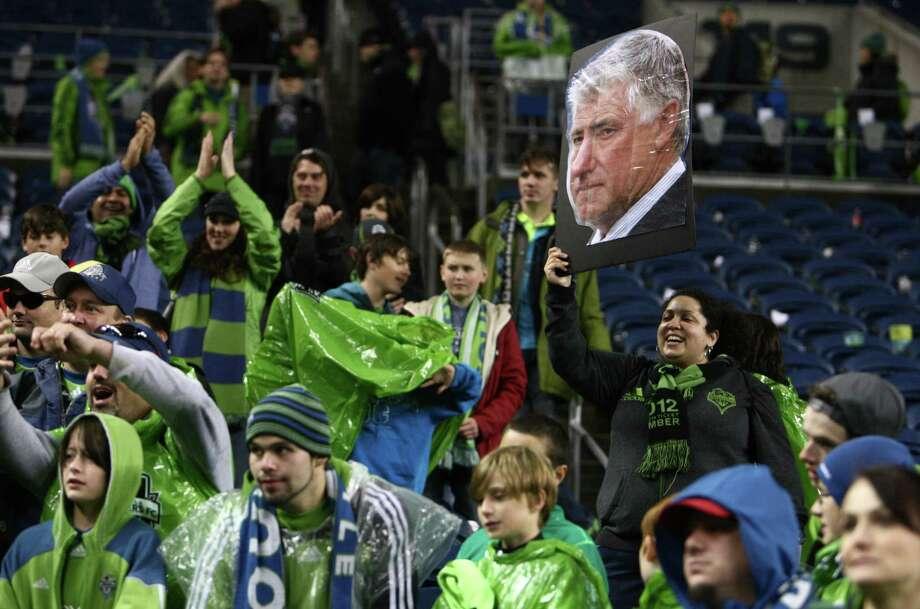 A fan holds a photo of Sounders coach Sigi Schmid. Photo: JOSHUA TRUJILLO / SEATTLEPI.COM