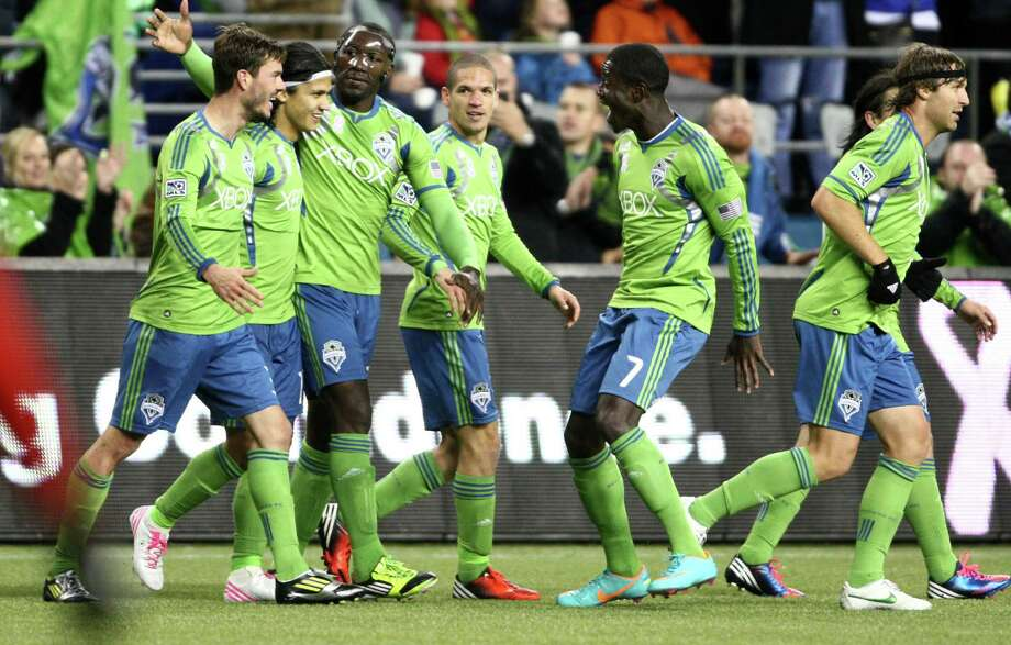 Sounders players celebrate Brad Evans' second-half goal. Photo: JOSHUA TRUJILLO / SEATTLEPI.COM