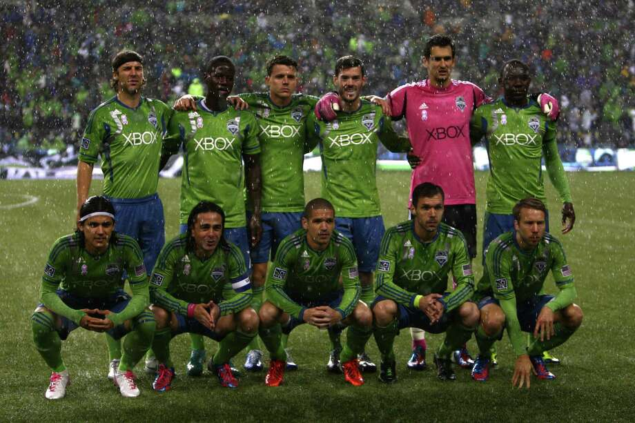 The Sounders pose for the pre-game photo in a pouring rain. Photo: JOSHUA TRUJILLO / SEATTLEPI.COM