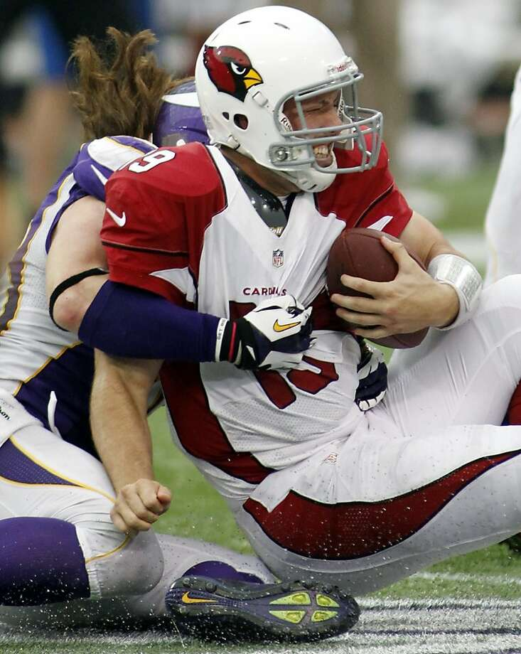 Cardinals backup quarterback John Skelton, starting because of a Kevin Kolb rib injury, was sacked seven times Sunday by the Vikings. Brian Robison brings him down on this play. Photo: Andy King, Associated Press