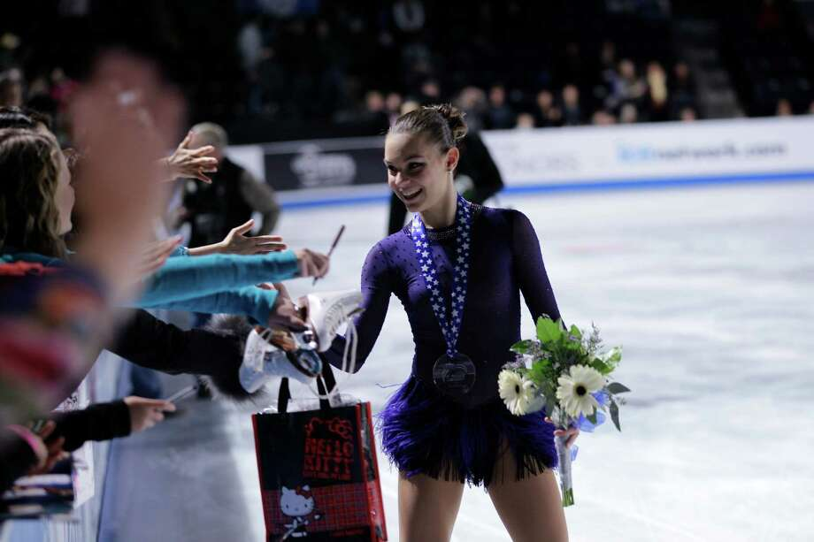 Russia's Adelina Sotnikova greets fans after competing. Photo: AP