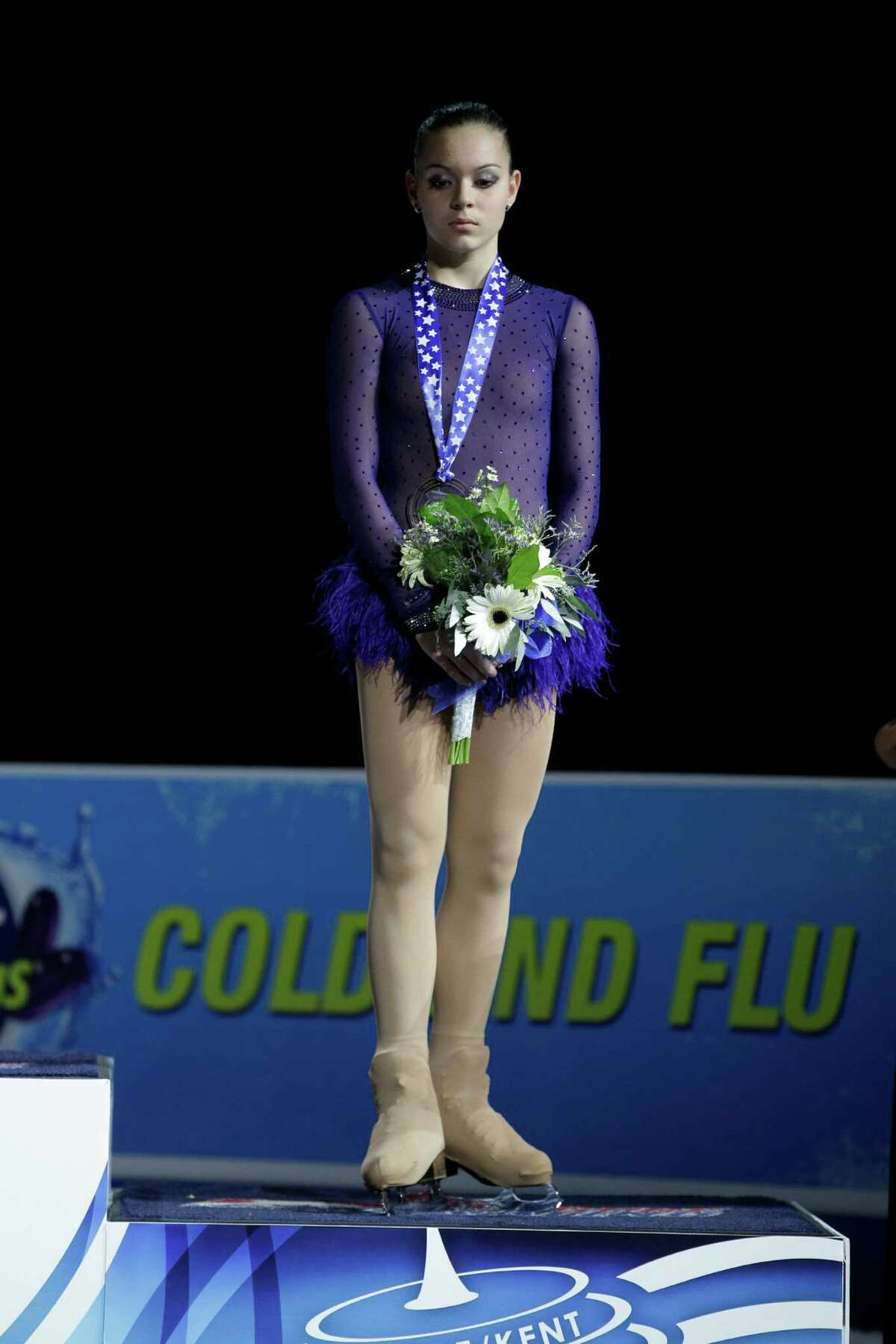 Russia's Adelina Sotnikova, stands on the podium after winning the bronze medal in the ladies free event.