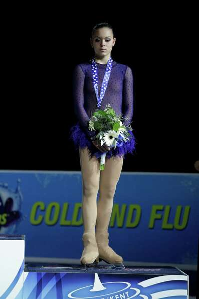Russia's Adelina Sotnikova, stands on the podium after winning the bronze medal in the ladies free e