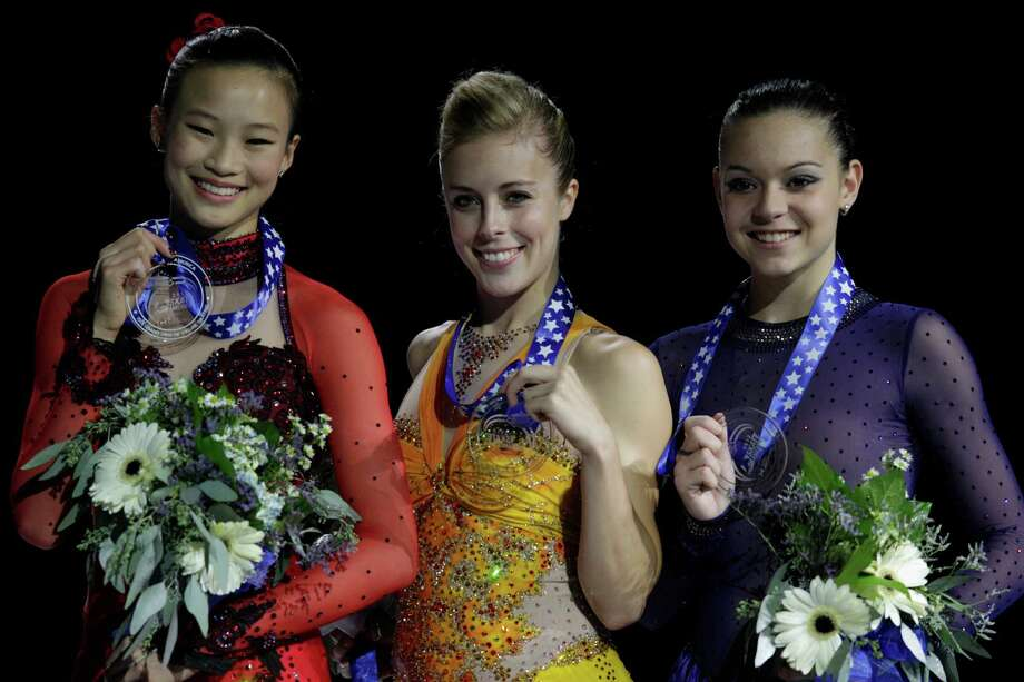From left, silver medal winner USA'a Christina Gao, gold medal winner USA's Ashley Wagner, and Russia's Adelina Sotnikova, who won the bronze, on the podium following the ladies free event. Photo: AP