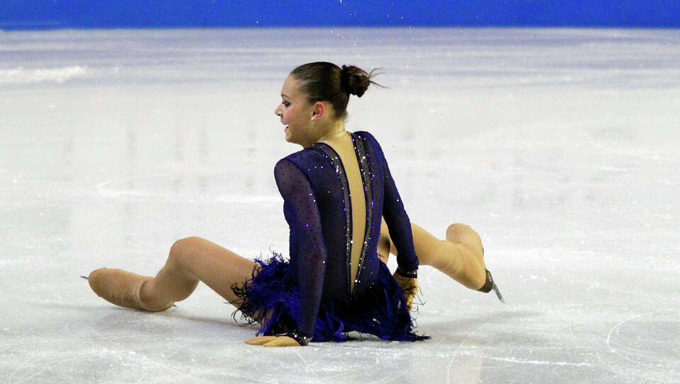 Russia's Adelina Sotnikova reacts after falling during her routine in the ladies free event. Sotniko