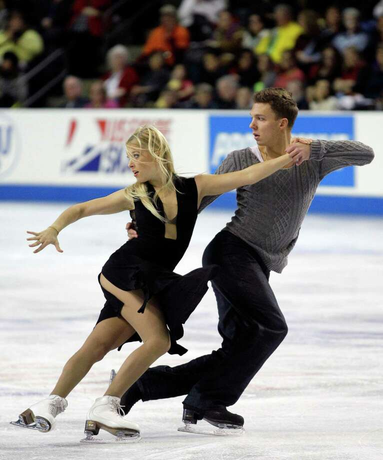 Russia's Ekaterina Bobrova, left, and Dmitri Soloviev perform in the ice dance event of the Skate America figure skating competition on Sunday, Oct. 21, 2012, in Kent, Wash. The pair won the silver medal in the event. Photo: AP