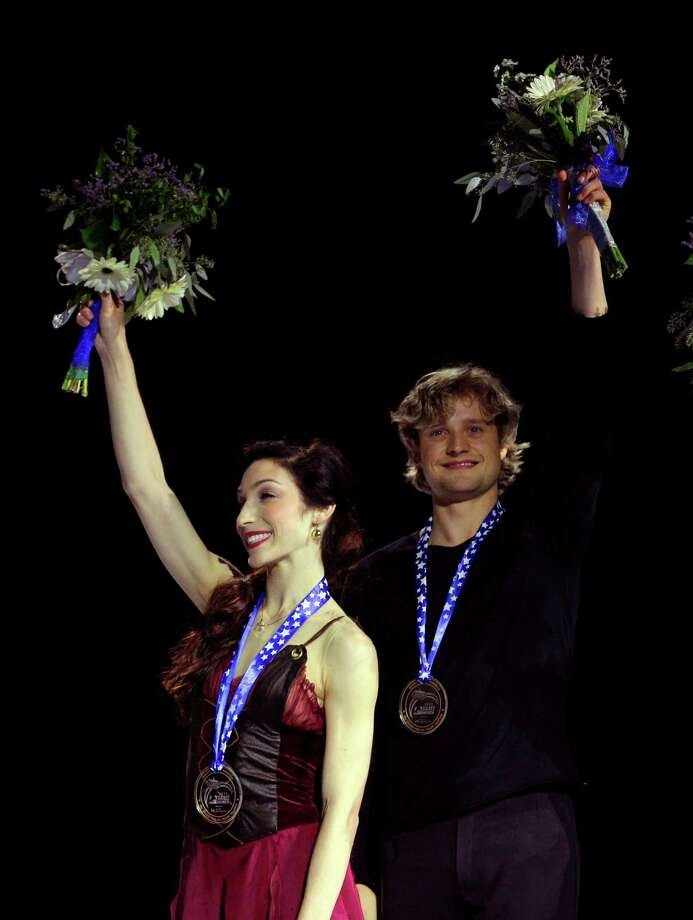 Charlie White, right, and Meryl Davis stand on the podium after being awarded the gold medal in the ice dance event of the Skate America figure skating competition on Sunday, Oct. 21, 2012, in Kent, Wash. Photo: AP