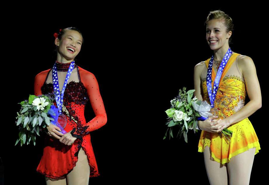 Gold medal winner Ashley Wagner, right, and silver medal winner Christina Gao, left, react on the podium following the ladies free event. Photo: AP