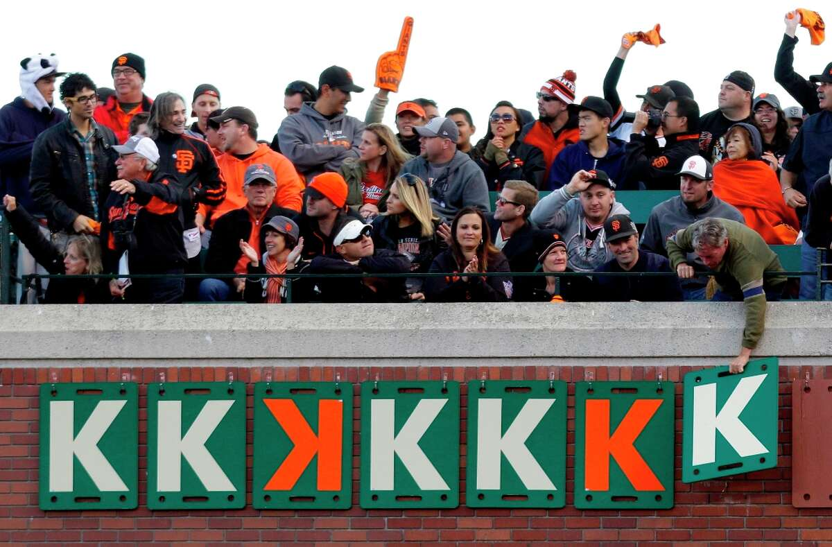 """Fans add a """"K"""" after a San Francisco Giants starting pitcher Ryan Vogelsong strikeout during the fourth inning of Game 6 of baseball's National League championship series against the St. Louis Cardinals Sunday, Oct. 21, 2012, in San Francisco."""
