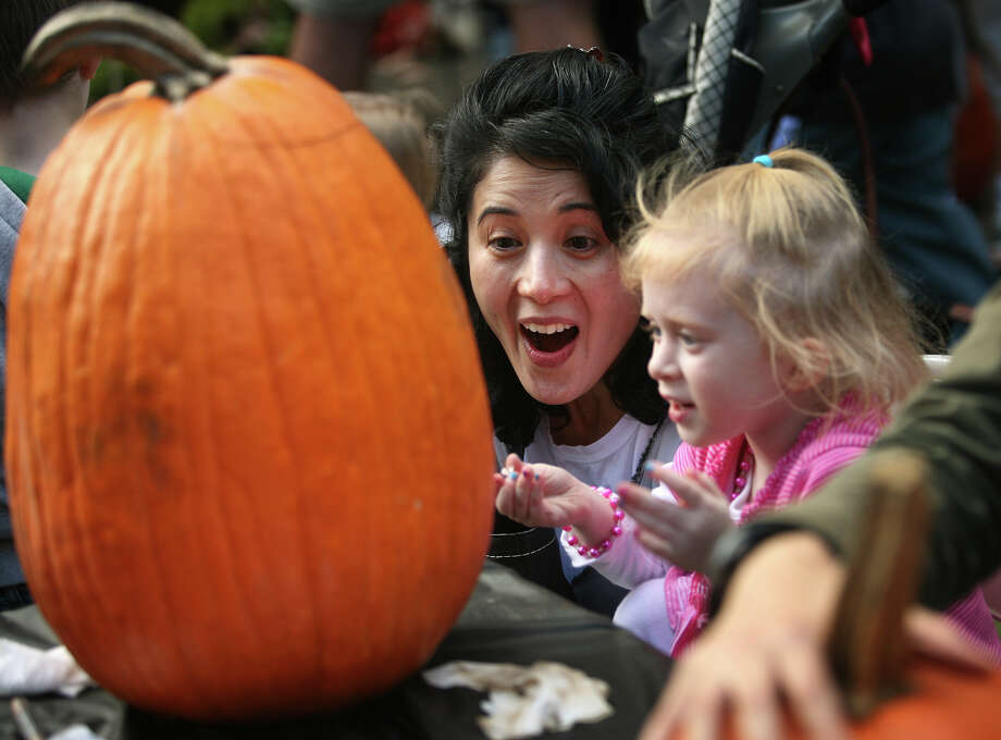 Anna Wood and her daughter Parker, 4 of Fairfield, create the face of their jack-o-lantern at a pumpkin carving fund raising event at St. Paul's Episcopal Church in Fairfield on Sunday, October 21, 2012. Photo: Brian A. Pounds / Connecticut Post