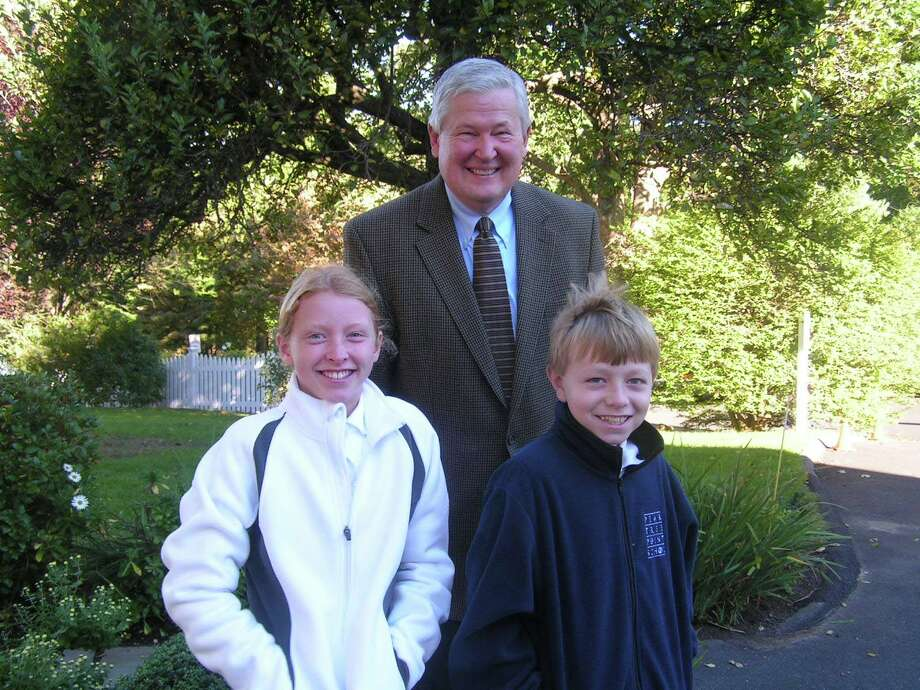 Ana Foster, headmistress of the day, and Ben Carpenter, headmaster of the day, join Pear Tree Point School Headmaster David Trigaux as they prepare to make their classroom rounds. Photo: Contributed