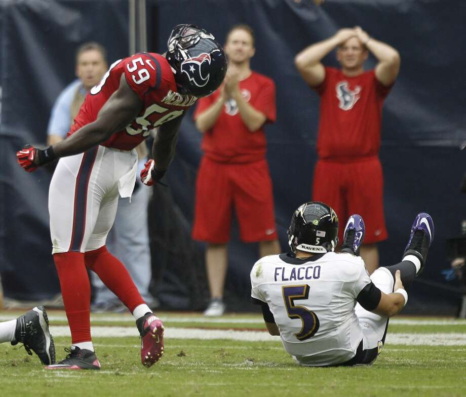 Texans linebacker Whitney Mercilus (59) reacts after stripping the ball from Baltimore Ravens quarterback Joe Flacco (5) during the first quarter. (Brett Coomer / Houston Chronicle)