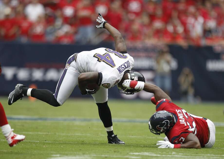 Texans inside linebacker Bradie James (53) tries to bring down Baltimore Ravens tight end Ed Dickson (84) by his helmet during the first quarter. (Brett Coomer / Houston Chronicle)