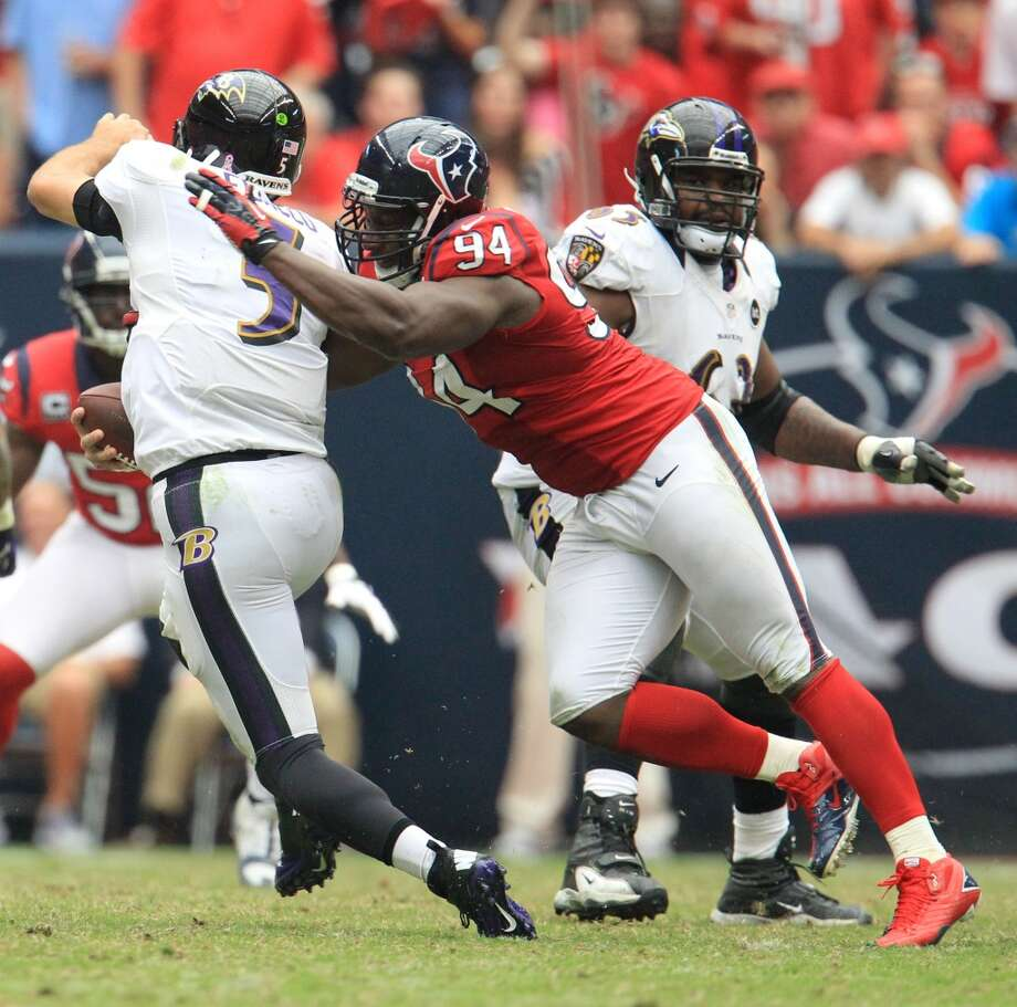 Texans defensive end Antonio Smith (94) sacks Ravens quarterback Joe Flacco (5) during the fourth quarter. (Karen Warren / Houston Chronicle)