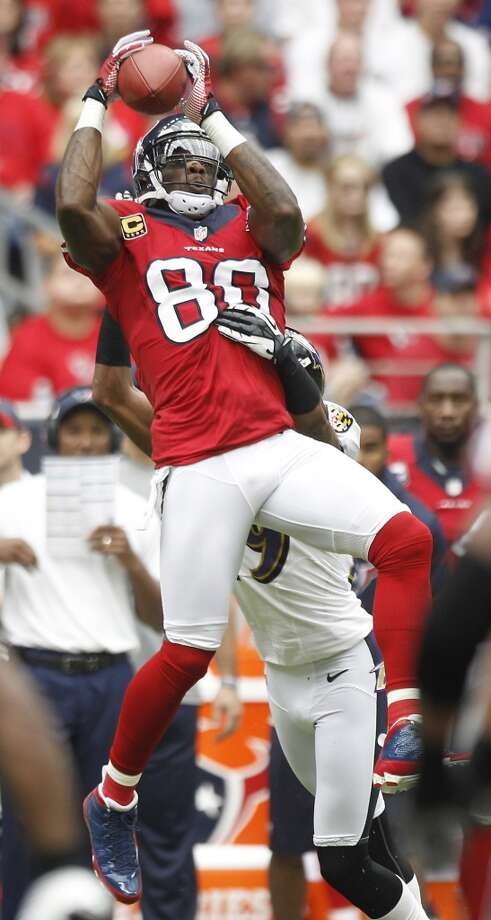 Texans wide receiver Andre Johnson (80) hauls in a pass over Ravens cornerback Cary Williams (29) during the first quarter. (Brett Coomer / Houston Chronicle)
