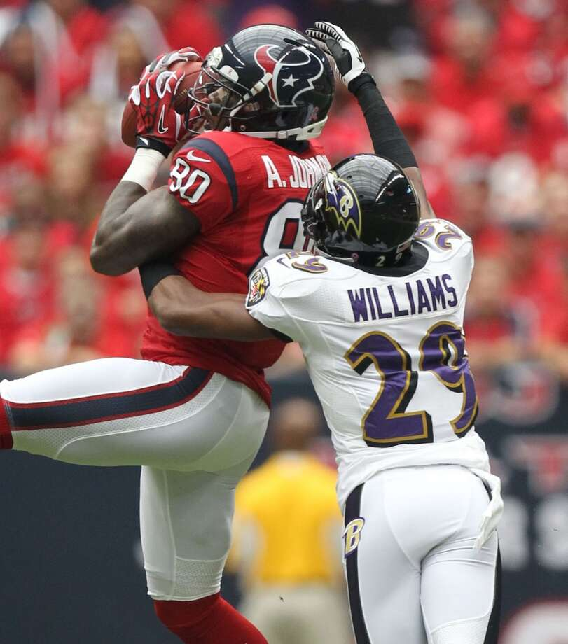 Texans wide receiver Andre Johnson (80) makes a catch over Ravens cornerback Cary Williams (29) during the first quarter. (Nick de la Torre / Houston Chronicle)