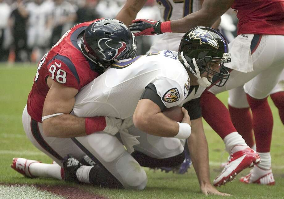Ravens quarterback Joe Flacco (5) is sacked for a safety by Texans outside linebacker Connor Barwin (98) during the first quarter. (Nick de la Torre / Houston Chronicle)