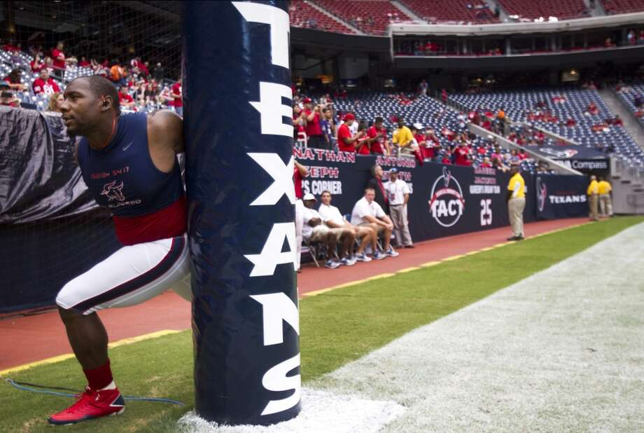 Texans defensive end Antonio Smith stretches before the Texans game against Baltimore. (Brett Coomer / Houston Chronicle)