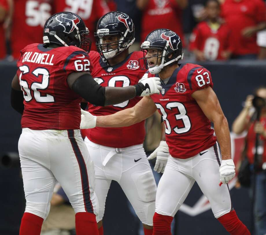 Texans wide receiver Kevin Walter (83) celebrates a touchdown with teammates during the first quarter. (Brett Coomer / Houston Chronicle)